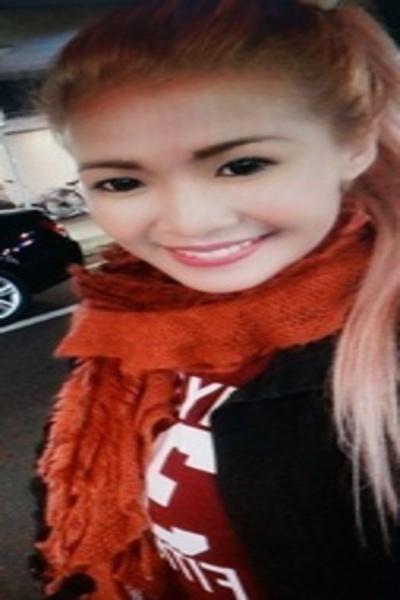 長い髪と笑顔がチャーミングなフィリピン女性20代