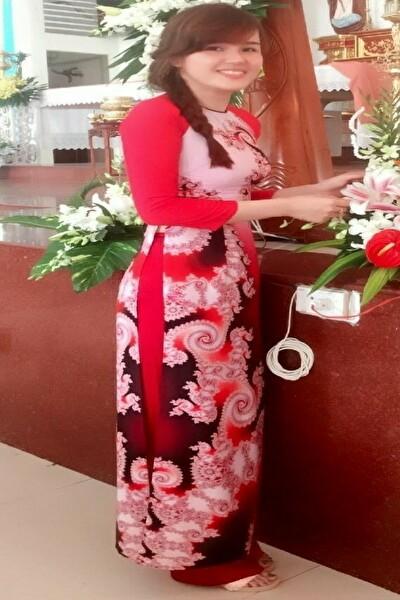 アオサイの似合う品格のあるベトナム女性30代